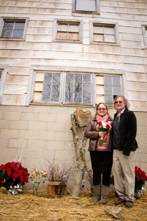 Married 12/13/14, Steven placed a heart-shaped log as our featured decoration for our wedding.